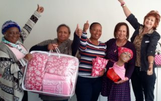 """A delighted Pretoria Chairperson Annemarie Joubert (right) and the """"Kalafong team """"(left to right) Minah Sookane, Jasmeen Joosub and Rita Mphokwane with National Chairperson Stephné Jacobs. Stephné 's 60th birthday wish was to gift 60 care sets to the newly established service at Kalafong Hospital."""