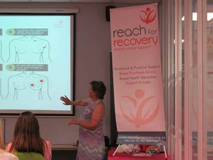 Estelle Botha teaching staff about the warning signs of breast cancer