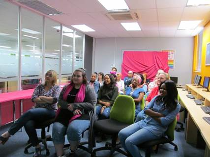 Ladies listening attentively to Estelle's presentation